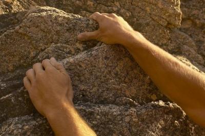 hands grabbing rock_400